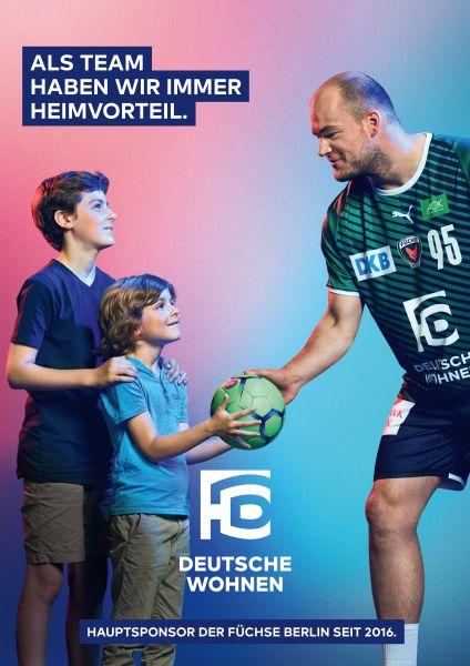 Pau Drux gives a handball to two little boys